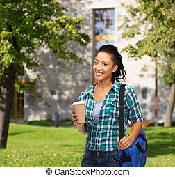 smiling student with bag and take away coffee cup -...