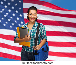 smiling student with folders, tablet pc and bag - education,...