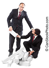 helping out a colleague - Two Businessman standing on a...