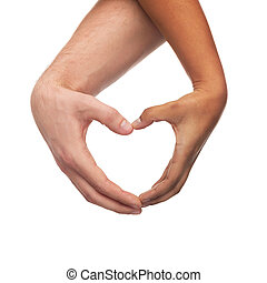 woman and man hands showing heart shape - love and...