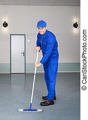 Worker Cleaning Floor - Happy Mature Male Worker Cleaning...