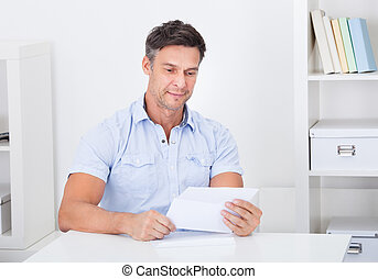 Mature Man Reading Letter - Happy Mature Man Reading Paper...