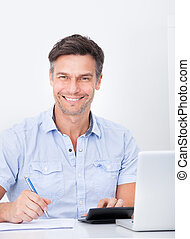 Man Calculating Finance - Portrait Of A Happy Mature Man...