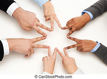 group of businesspeople showing v-sign - business and...