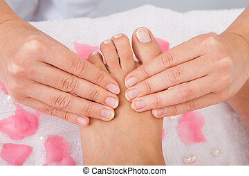 Womans Feet Receiving Foot Massage - Close-up Of Womans Feet...