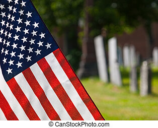 American Flag at Cemetary - Closeup of an American flag with...