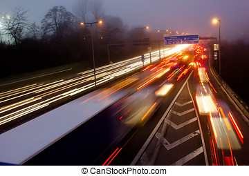 Motorway at Night - Highway during Evening Rush Hour in...