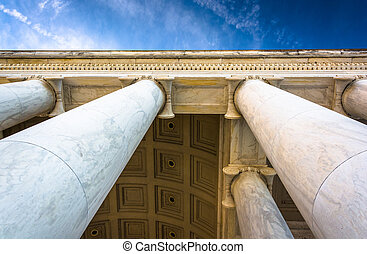 Looking up at columns at the Thomas Jefferson Memorial,...