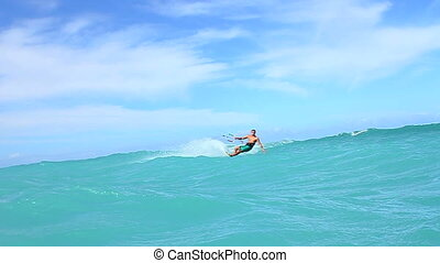 Young Man Kiteboarding In Ocean - Young fit man having fun...