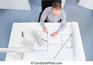 Architect Drawing On Blueprint - Portrait Of A Mature...