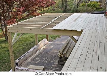 Half Built Deck - An exterior wooden deck half built in...