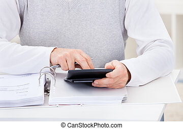 Happy Mature Man Holding Calculator And Bills - Close-up Of...