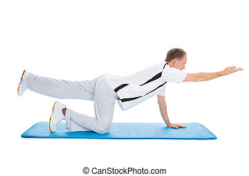 Portrait Of Mature Man Exercising