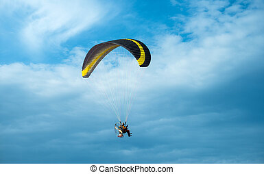 Paragliding fly on blue sky - Paragliding fly on blue cloudy...