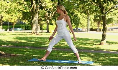Beautiful blonde woman doing yoga