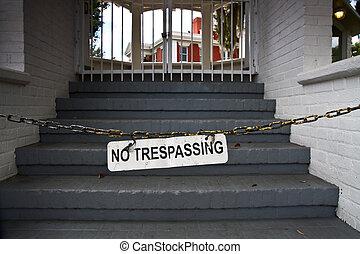 No tresspassing sign blocking stairs