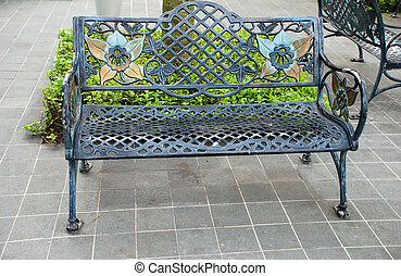 iron bench - ornamental iron bench on the city street