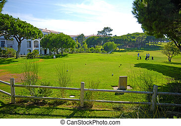 The hotel and golf course on a sunny day - The hotel and...