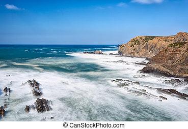 Seascape waves erode the coast Portugal Algarve