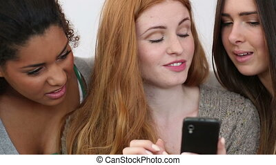 Young women holding smartphone on white background