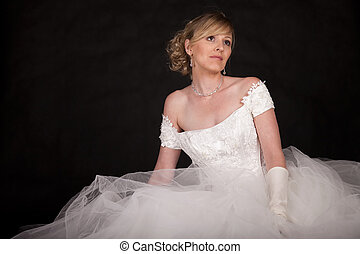 Woman in wedding gown - Attractive blond woman wearing white...