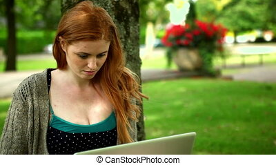 Calm female student working with notebook