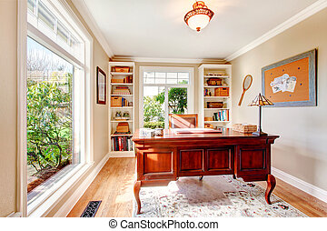 Bright office room with classic desk and built-in shelves -...