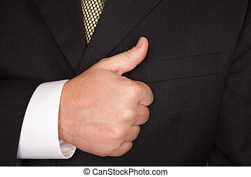 Businessman Gesturing Thumbs Up with Hand - Businessman in a...