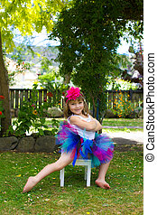 Little girl all dressed up in a colourful tutu