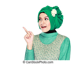young moslem woman pointing - Portrait of beautiful young...