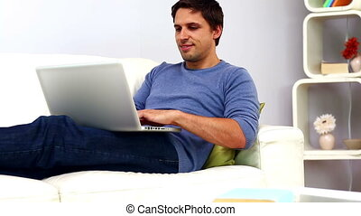 Calm casual man using his notebook