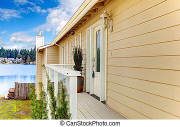 Siding house wiht front deck - Wood deck with white railings...