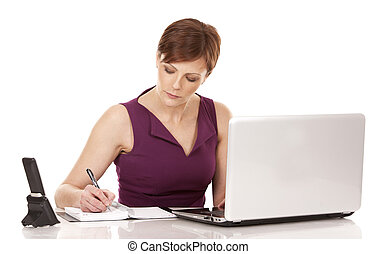 business woman working with her laptop sitting down on white...