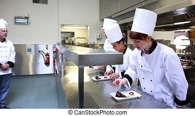 Head chef inspecting his students d