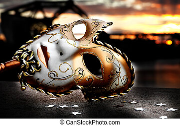 Venetian Mask by the River Bridge with Sunset