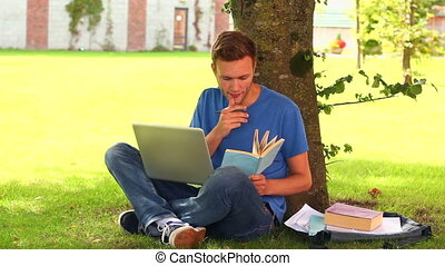 Focused student studying outside on college campus