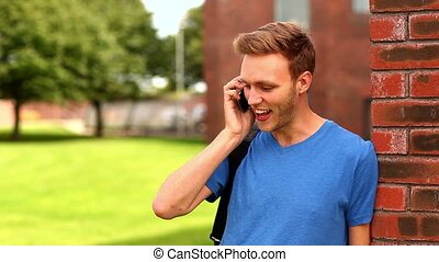Happy student talking on the phone