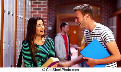 Two students laughing and talking