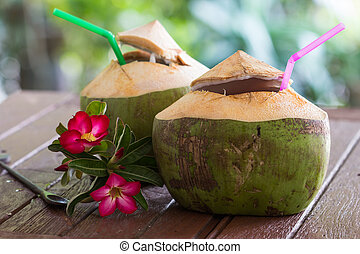 coconut water drink - Coconut water is placed on the table...