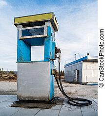 Old gas pump - Vintage old gas pump on blue sky