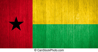 Guinea-Bissau Flag on wood background