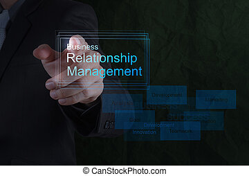 Businessman hand show business relationship management on the new computer interface as concept
