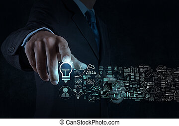 businessman hand touch light bulb sign and business strategy...