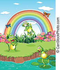 Three playful frogs at the pond and a rainbow in the sky -...