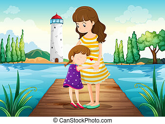 A young girl hugging her mother at the bridge