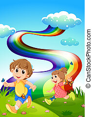 Kids walking at the hill with a rainbow in the sky -...