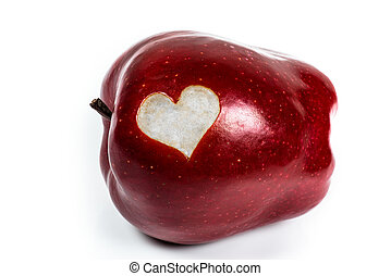 Red Delicious apple with a cutout heart on a white...