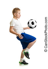 Boy kicking soccer ball by knee isolated on white. Training...