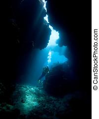 Scuba Diver - a female scuba diver in an underwater cave...
