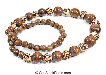 Necklace made of brown wooden balls isolated on white